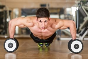 guy-doing-pushups-with-dumbells