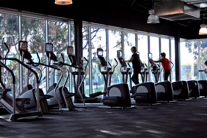 people-exercising-in-a-elliptical-trainer