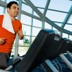 A guy running in a treadmill