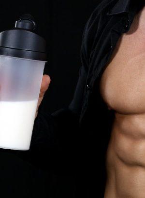Bodybuilder holding creatine powder